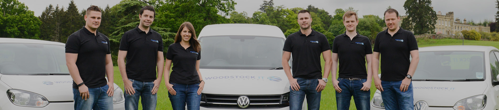 Woodstock IT banner image employees infront of Woodstock cars and van